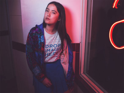 Mockup of a Girl Wearing a T-Shirt With Blue Clothes on Top of It While Near a Red Light a13590