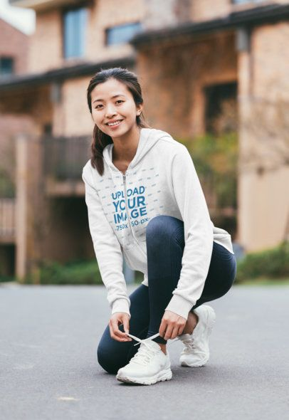 Hoodie Mockup of a Happy Jogger Fixing Her Shoelaces 40820-r-el2
