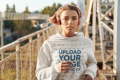 Mockup of a Young Woman Wearing a Hoodie to Run in the City 40262-r-el2