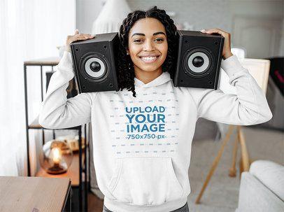 Hoodie Mockup of a DJ Holding Two Loud Speakers 39076-r-el2