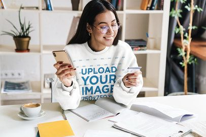Mockup of a Woman with a Sweatshirt Doing Online Shopping at Home 39835-r-el2