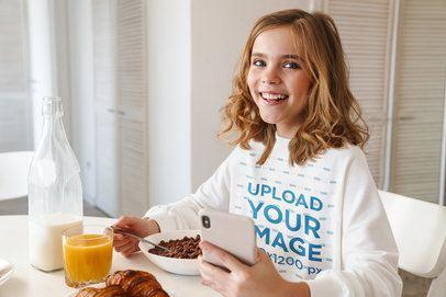 Sweatshirt Mockup Featuring a Girl Having Cereal for Breakfast 39834-r-el2