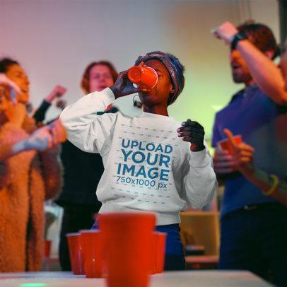 Sweatshirt Mockup of a Woman Playing Beer Pong at a Party 43546-r-el2