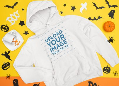 Mockup of a Flat Laid Pullover Hoodie Surrounded by Halloween Decor 90