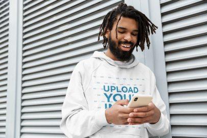 Pullover Hoodie Mockup of a Happy Man Texting 41648-r-el2