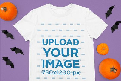 Halloween-Themed Mockup Featuring a T-Shirt Surrounded by Pumpkins m106