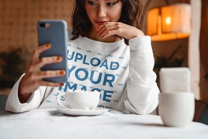 Sweatshirt Mockup of a Woman Taking a Selfie in a Coffee Shop 40253-r-el2