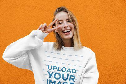Crewneck Sweatshirt Mockup of a Happy Woman Doing a Peace Sign 39822-r-el2