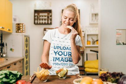 Basic T-Shirt Mockup of a Young Woman Making Dinner 37794-r-el2