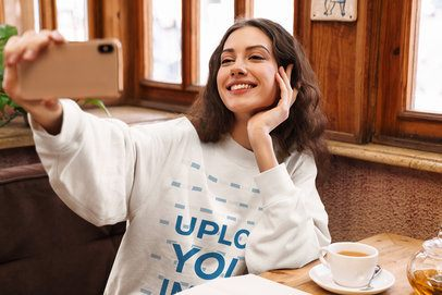 Crewneck Sweatshirt Mockup of a Woman Taking a Selfie at a Cafe 40246-r-el2