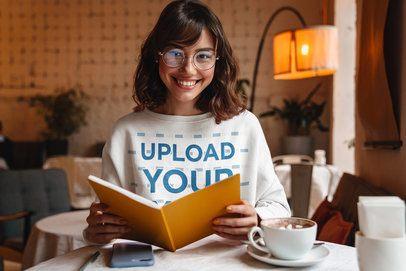 Mockup of a Smiling Woman Wearing a Sweatshirt in a Coffee Shop 40251-r-el2