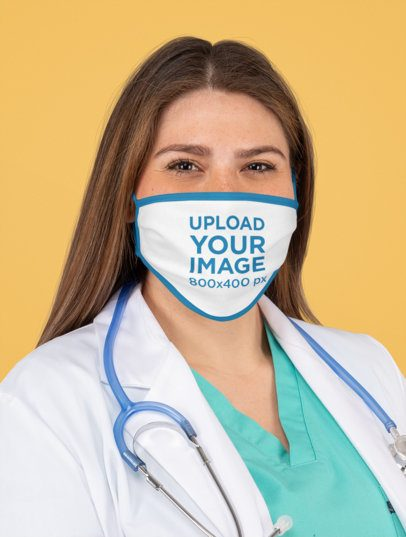 Portrait Mockup of a Doctor Wearing a Face Mask in a Studio m177