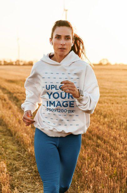 Mockup of a Woman in a Hoodie Running Outdoors 42803-r-el2