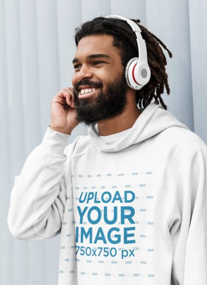 Pullover Hoodie Mockup of a Man Listening to Music on His Headphones 41724-r-el2