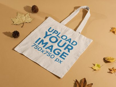 Tote Bag Mockup Featuring Dried Leaves and Pine Cones m123