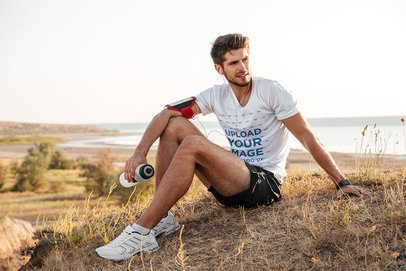 T-Shirt Mockup Featuring a Runner and a Beach in the Background 42744-r-el2