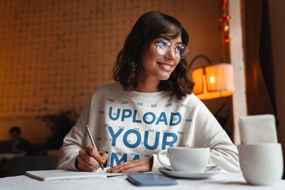 Sweatshirt Mockup of a Woman Writing at a Cafe 40252-r-el2