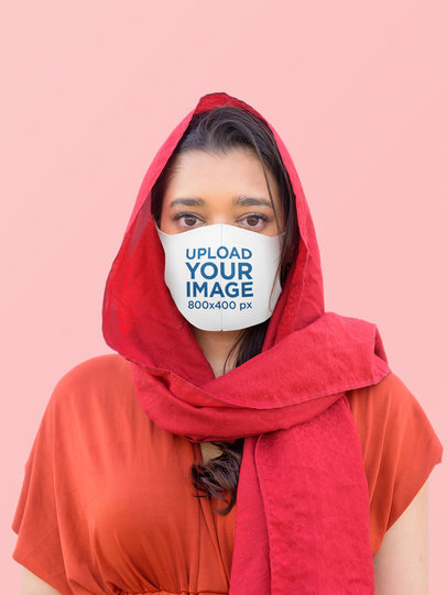 Mockup Featuring a Serious Woman Using a Sublimated Face Mask at a Studio 44036-r-el2