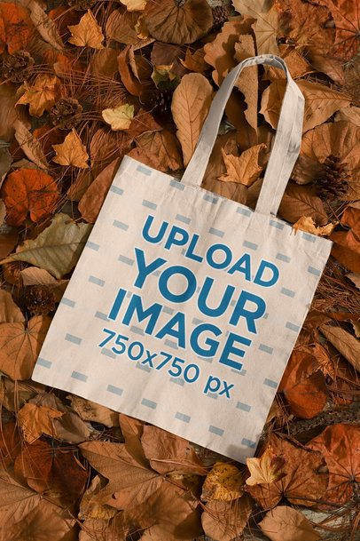 Mockup of a Sublimated Tote Bag Placed Over a Bunch of Autumn Leaves 134