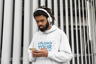 Hoodie Mockup of a Bearded Man Listening to Music on His Phone 42623-r-el2