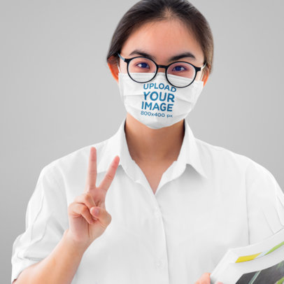 Face Mask Mockup of a Woman Making a Peace Sign 43940-r-el2