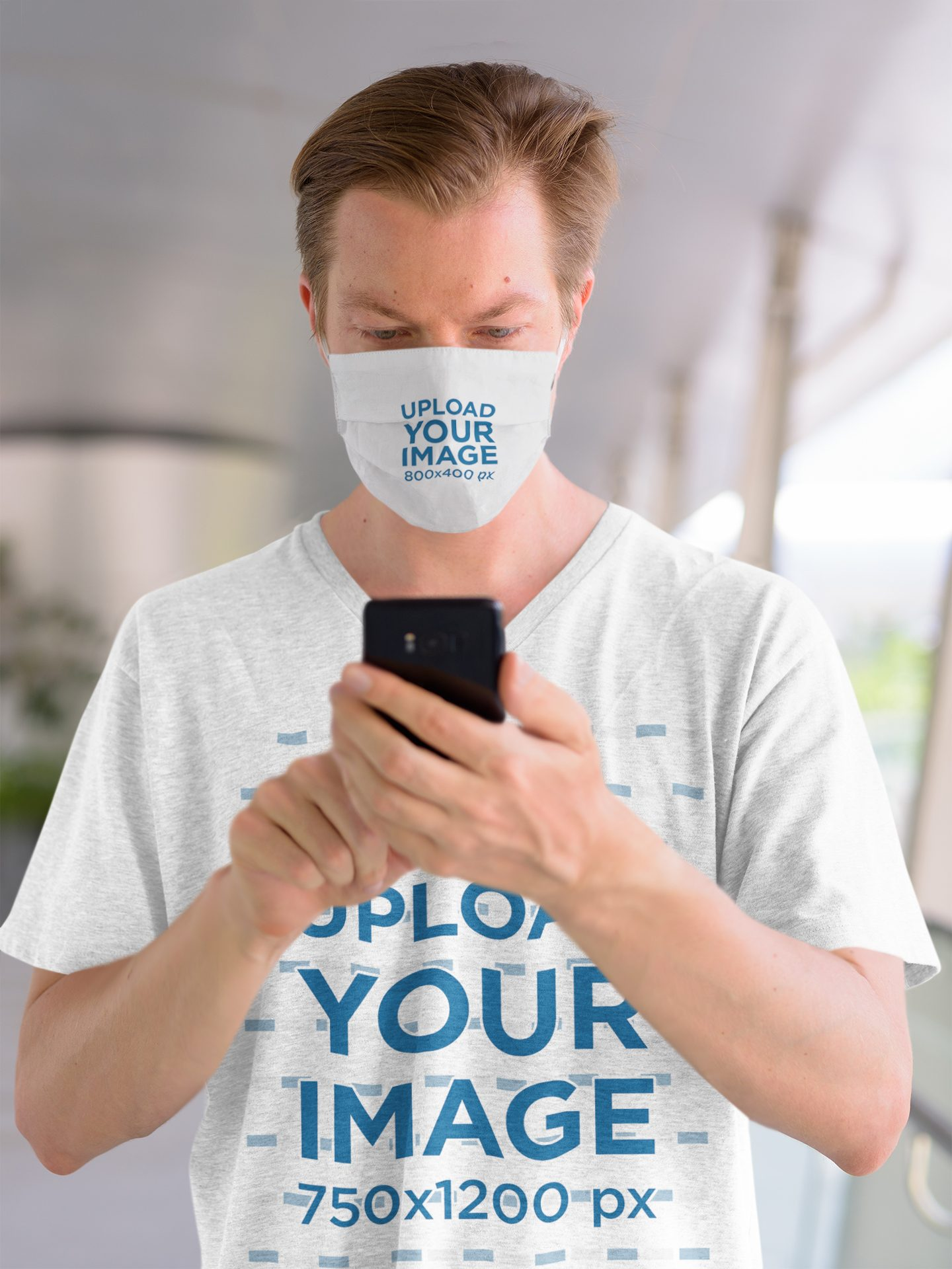 Heather T-Shirt and Face Mask Mockup of a Man Checking His Phone 43825-r-el2
