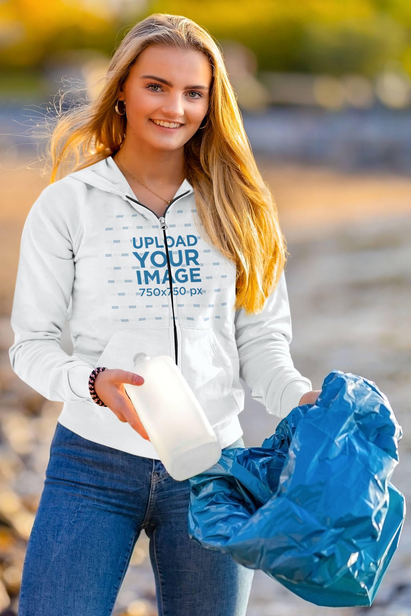 Full-Zip Hoodie Mockup of a Woman Cleaning a Beach 43840-r-el2
