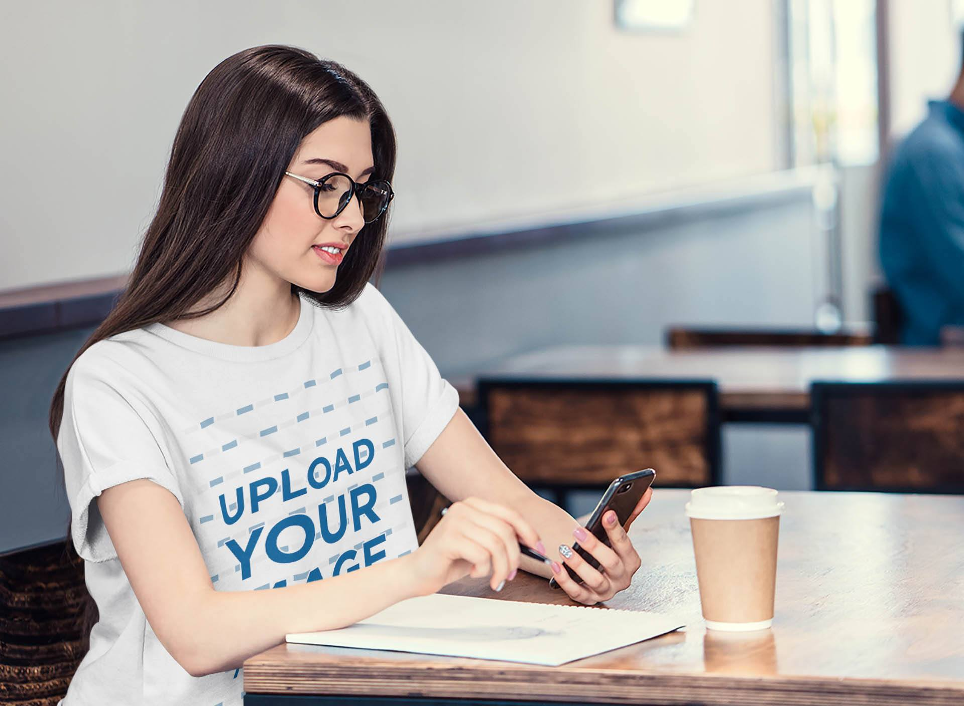 T-Shirt Mockup of a Woman with Glasses Studying at a Coffee Shop 35506-r-el2