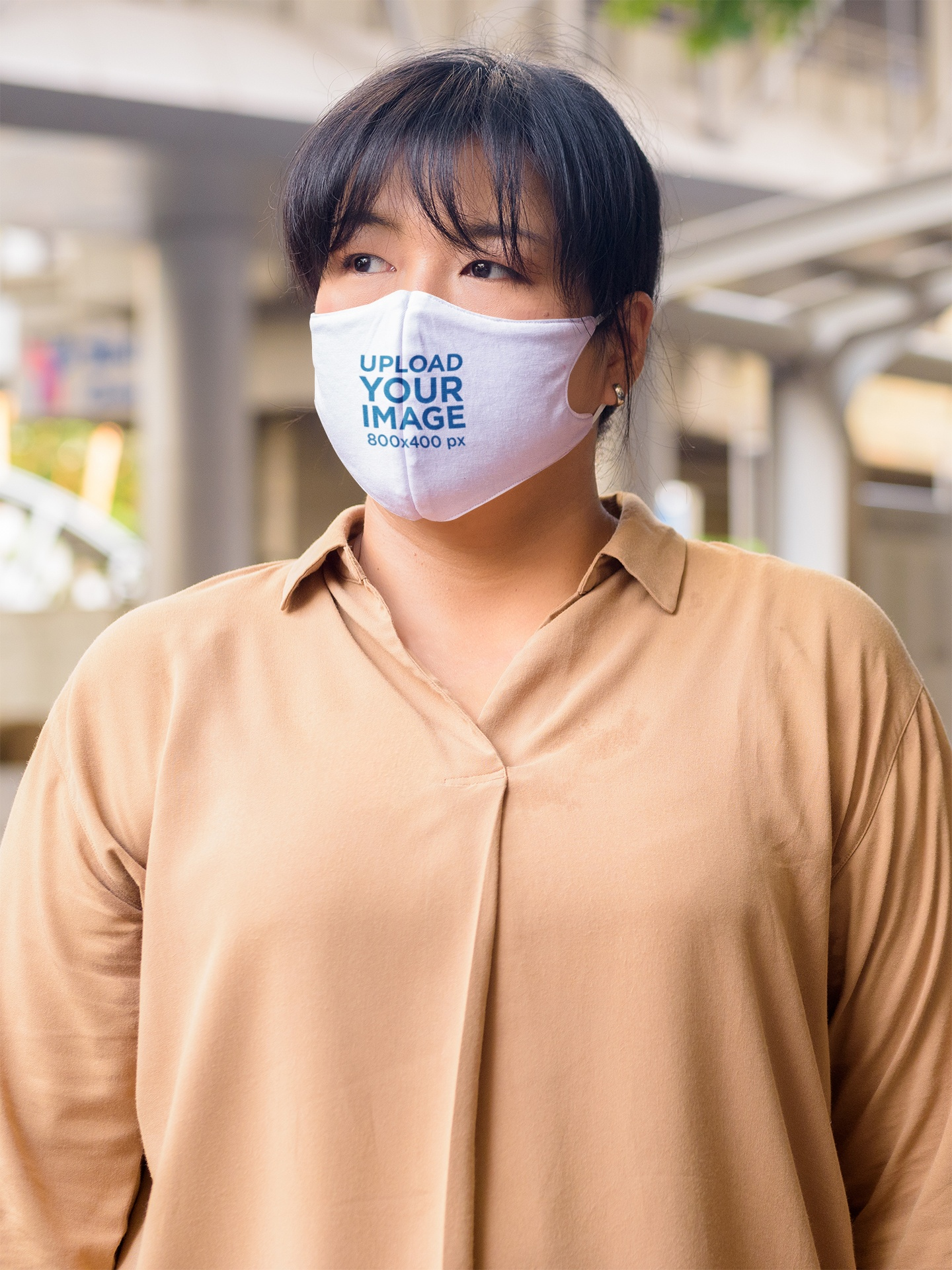 Mockup of a Serious Woman Wearing a Face Mask on the Street 44023-r-el2