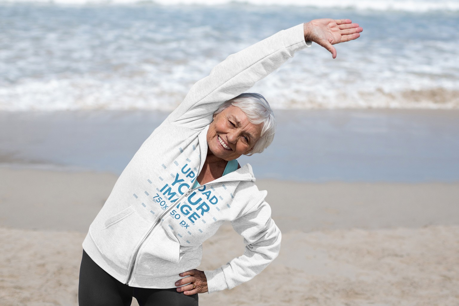 Full-Zip Hoodie Mockup of a Senior Woman Working Out at the Beach 42634-r-el2