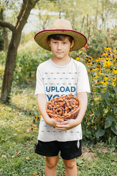 Mockup of a Kid with a T-Shirt Holding a Basket of Chestnuts 35514-r-el2