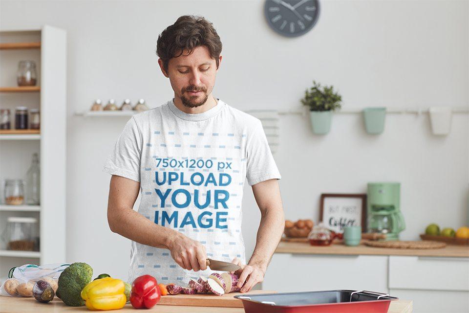 T-Shirt Mockup of a Man Cooking Veggies at Home 40093-r-el2