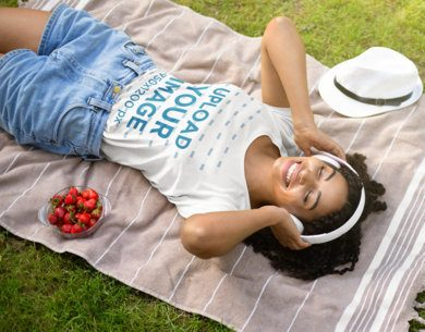 T-Shirt Mockup of a Woman Listening to Music on a Picnic 42172-r-el2