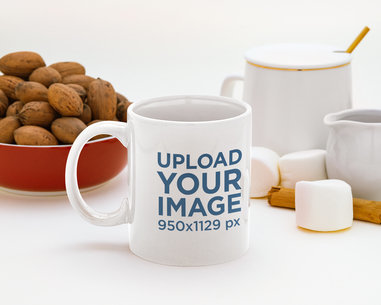 Mockup of an 11 oz Coffee Mug Surrounded by Marshmallows and Walnuts m149