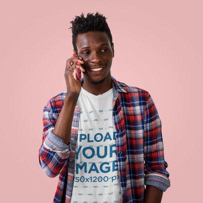 Studio Mockup of a Man in a T-Shirt Talking on the Phone 40414-r-el2