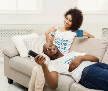 T-Shirt Mockup of a Happy Couple Watching TV in Their Living Room 37549-r-el2