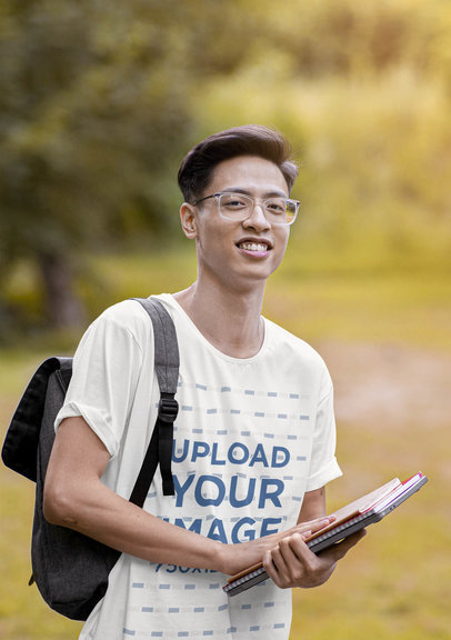T-Shirt Mockup of a Student in a Campus with Nature 42277-r-el2