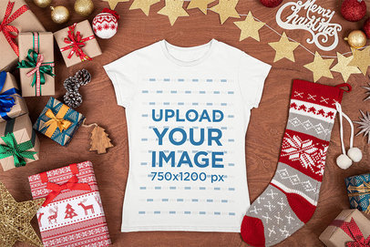 Mockup of a Flat Laid Tee Surrounded by Christmas Presents and Decorations m33
