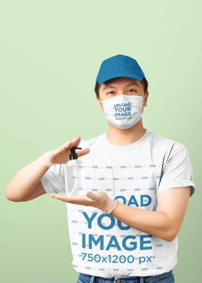 T-Shirt and Face Mask Mockup of a Man Holding a Bottle of Sanitizer 43661-r-el2