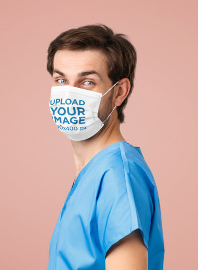 Face Mask Mockup of a Male Health Professional Standing in a Studio 43985-r-el2