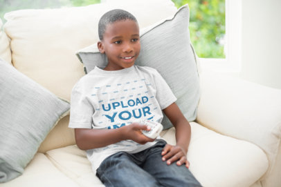 T-Shirt Mockup of a Kid Watching TV on a Couch 43919-r-el2