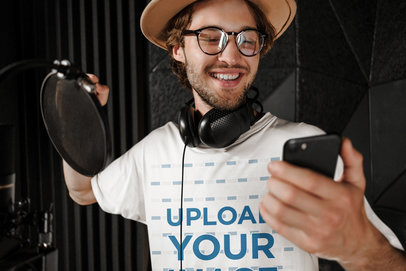 T-Shirt Mockup of a Happy Male Singer Checking His Phone 40166-r-el2