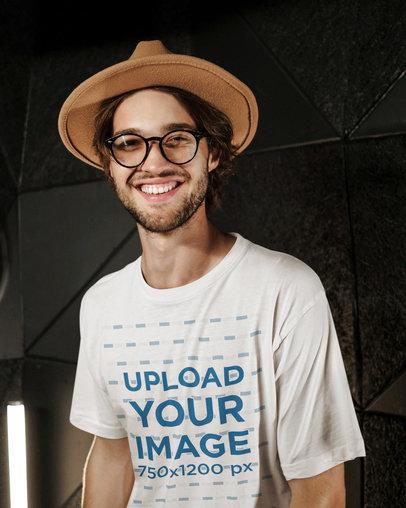 T-Shirt Mockup of a Joyful Bearded Man Posing Against a Dark Wall 40207-r-el2