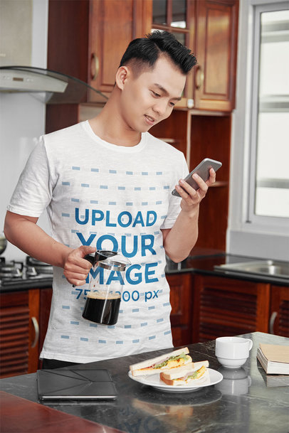 T-Shirt Mockup of a Man Having Breakfast at His Kitchen 42311-r-el2