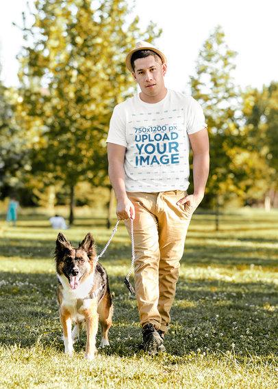 T-Shirt Mockup of a Man Walking His Dog at a Park 42973-r-el2
