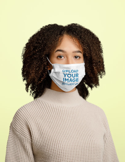 Face Mask Mockup of a Curly-Haired Woman Standing in a Studio 44687-r-el2