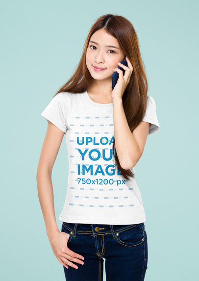 Crew Neck T-Shirt Mockup of a Woman Making a Call While Standing Against a Plain Backdrop 44569-r-el2