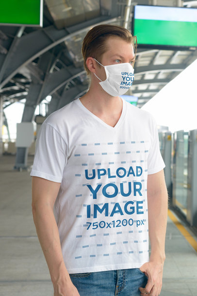 T-Shirt Mockup of a Man With a Face Mask Waiting for a Train 44464-r-el2