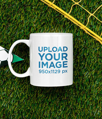 Mockup of an 11 oz Coffee Mug Placed on a Soccer Field m396