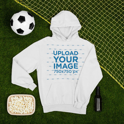 Pullover Hoodie Mockup Featuring a Soccer Ball and a Popcorn Bowl m391